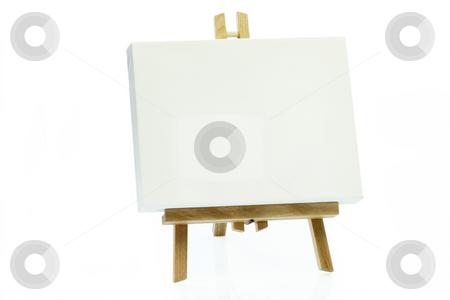 Art easel stock photo, Wooden art easel on bright background. by Birgit Reitz-Hofmann