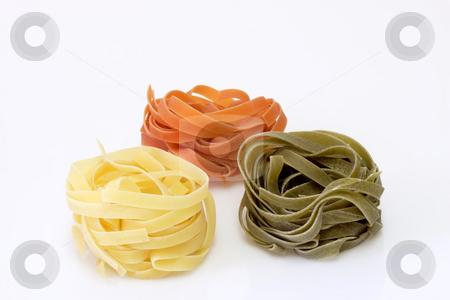 Noodles_9 stock photo, Raw pasta on bright background. Shot in Studio. by Birgit Reitz-Hofmann