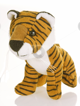 Tiger stripes stock photo, Cute stuffed animal tiger on white background by Birgit Reitz-Hofmann