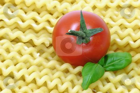 Noodles_3 stock photo, Raw pasta on bright background. Shot in Studio. by Birgit Reitz-Hofmann
