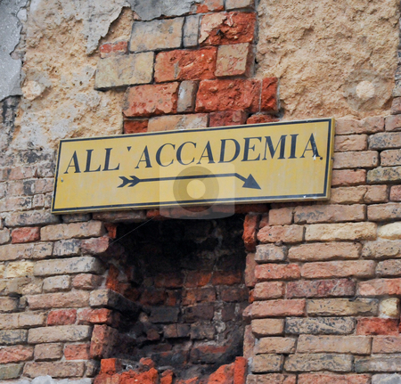 Accademia sign on brick wall stock photo, Sign on old brick wall pointing to Accademia by Jaime Pharr