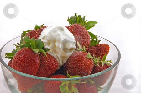 Bowl of Strawberries and Whipped Cream stock photo, This is a closeup of a bowl of fresh strawberries and a dollop of whipped cream.  They are in a clear bowl and white background. by Valerie Garner