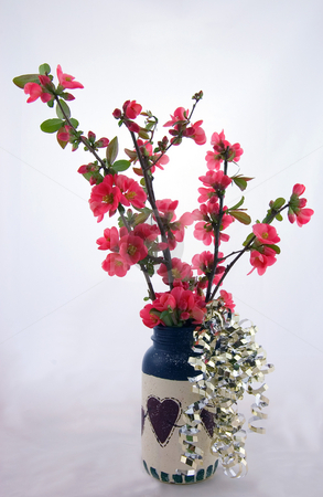 Americana Primite Vase with Gold & Flowers stock photo, This Americana primitive type vase is filled with flowering quince coral colored flowers, with some gold metallic filled trailing on the sides.  This still life is a 4th of July theme. by Valerie Garner