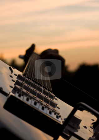 Electric guitar at sunset stock photo,  by MWilkinson Photography