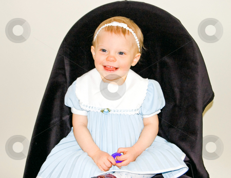 1 Year Old Toddler Girl in Blue Dress stock photo, This is a portrait photo of a 1 year old Caucasian toddler girl smiling in a formal pale blue dress. by Valerie Garner