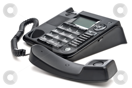 Horizontal closeup of a black business telephone with the reciev stock photo, Horizontal closeup of a black business telephone with the reciever off the hook by Vince Clements