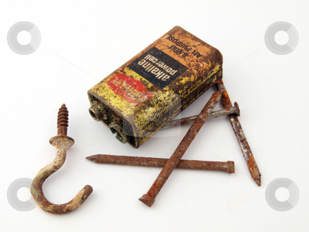 Rusty battery and nails stock photo, Rusty battery with nails and a hook. by Ian Langley