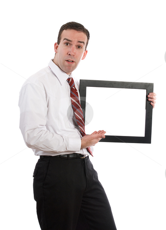 Man Holding Copyspace stock photo, A young man holding and showing a frame with white copyspace inside by Richard Nelson