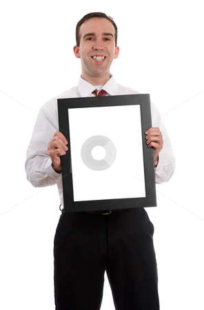 Man Holding Frame stock photo, A young employee is holding up a frame with copy-space inside, isolated against a white background by Richard Nelson