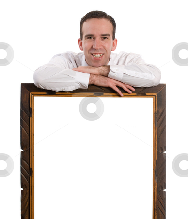 Advertisement stock photo, A young man leaning on your advertisement with his arms crossed and smiling, isolated against a white background by Richard Nelson