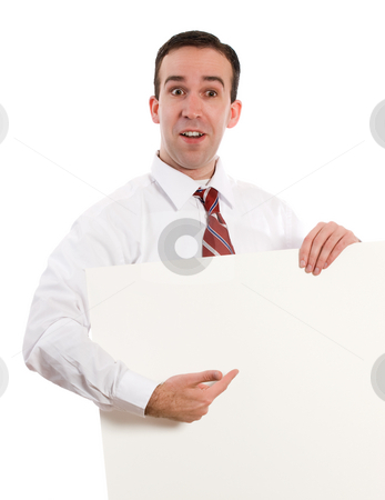 Showing Your Text stock photo, A young employee holding a white sheet of paper and pointing to your text by Richard Nelson
