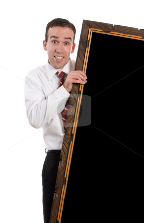 Businessman Holding Large Frame stock photo, An employee wearing a shirt and tie is holding a large wooden frame with black copy-space inside, all isolated against a white background by Richard Nelson