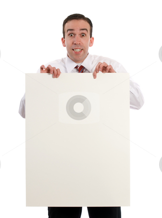 Man Holding Sheet Of Paper stock photo, A young businessman holding up a blank sheet of paper, isolated against a white background by Richard Nelson
