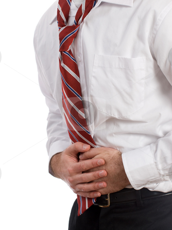 Diarrhea stock photo, Closeup view of a man wearing a suit and tie, holding his stomach symbolizing that he is suffering from diarrhea, isolated against a white background by Richard Nelson
