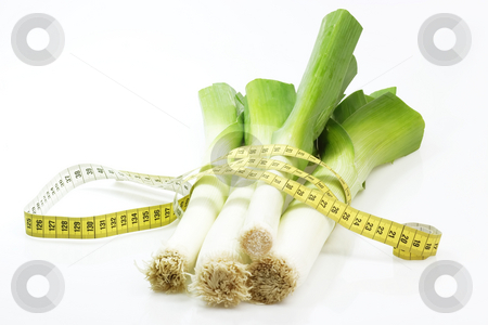 Leek diet stock photo, Fresh leek with measuring tape on bright background by Birgit Reitz-Hofmann