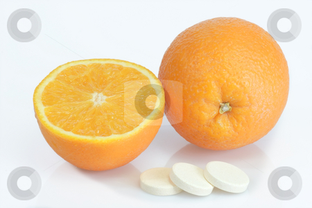 Vitamins_1 stock photo, Large pills with orange fruits tube on bright background by Birgit Reitz-Hofmann