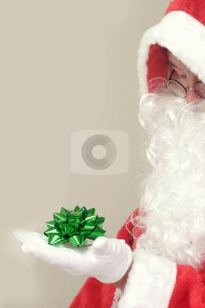 Gift ribbon stock photo, Male caucasian model of santa claus on grey background by Birgit Reitz-Hofmann