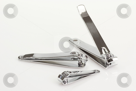 Siver nailclipper stock photo, Silver nail clipper one bright background by Birgit Reitz-Hofmann