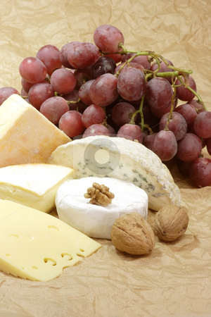 Cheese_2 stock photo, Stillife with cheese on brown background by Birgit Reitz-Hofmann