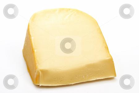 Gouda cheese stock photo, A big chunk of gouda cheese on bright background by Birgit Reitz-Hofmann