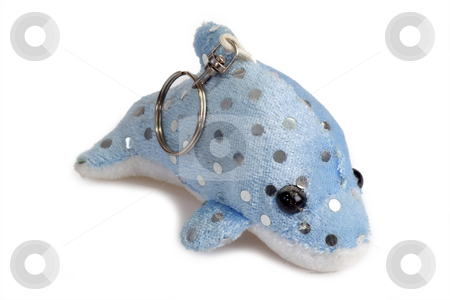 Key holder stock photo, Dolphin soft toy as key holder on bright background by Birgit Reitz-Hofmann
