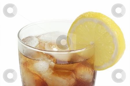 Lemon ice tea_2 stock photo, A glass full of Ice Tea with a lemon slice on bright background by Birgit Reitz-Hofmann