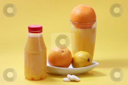 Yellow vitamins stock photo, Orange juice with effervescent tablets with glass and fruits on yellow background by Birgit Reitz-Hofmann