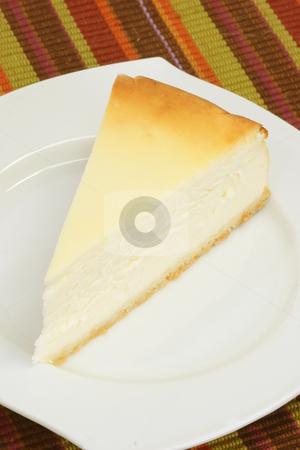 Cheesecake stock photo, Slice of cheesecake on a kitchen plate by Birgit Reitz-Hofmann