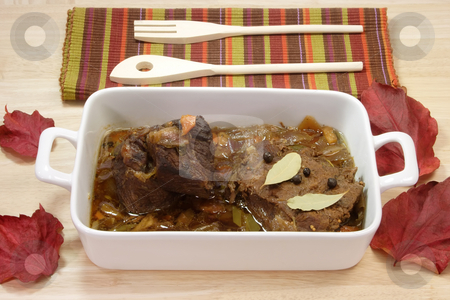 Marinated beef_3 stock photo, Cooked marinated beef meat in a bowl with wooden spoon. by Birgit Reitz-Hofmann