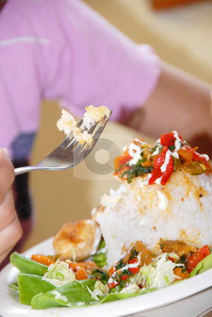 Rice dinner stock photo, Rice and vegetables served on plate, rice on fork by Julija Sapic