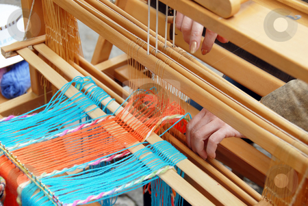 Vintage weaving stock photo, Wooden vintage loom, producing handmade garment by Julija Sapic