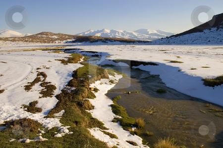 Snow Melting stock photo, Snow melting in Turkish mountain at spring by Kobby Dagan