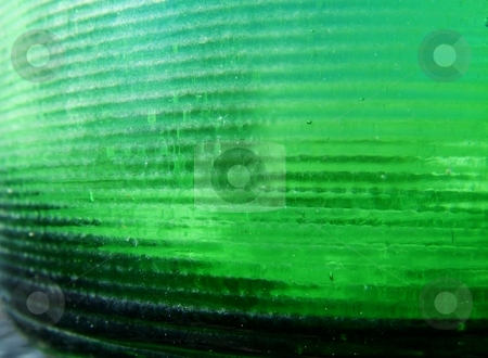 Glass Bottle	 stock photo, Macro of the base of an old, green bottle. by Krystal McCammon
