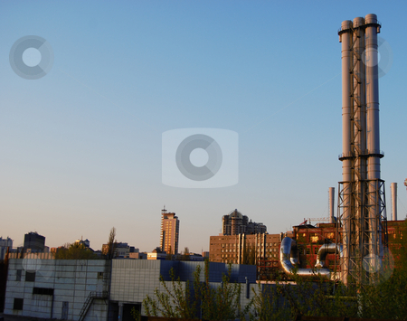 Factory's chimneys  stock photo, Industrial city view with chimneys and skyscraper by Leyla Akhundova