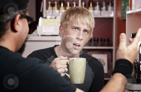 Coffee House Conversation stock photo, Shocked young blonde man reacting to coffee house conversation by Scott Griessel
