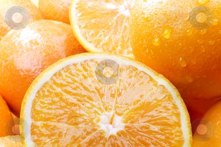Oranges stock photo, Studio shot of group of oranges, some sliced in half by iodrakon
