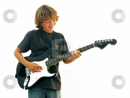 Smiling Teen Boy Playing Guitar stock photo, Smiling teen boy playing electric guitar isolated over white. by Denis Radovanovic
