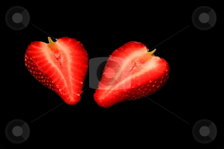 Strawberry stock photo, Isolated strawberry on black background by Jack Schiffer