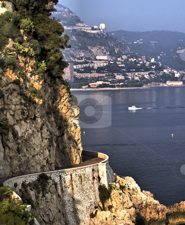 Lower Corniche Road on French Riviera stock photo, The lower cornich road with Monaco in background. by GB Tittle