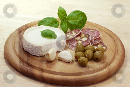 Appetizer stock photo, Gourmet food on a brown kitchen board by Birgit Reitz-Hofmann
