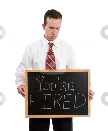You Are Fired stock photo, A young teacher looking down at his chalk board which says you're fired, isolated against a white background by Richard Nelson