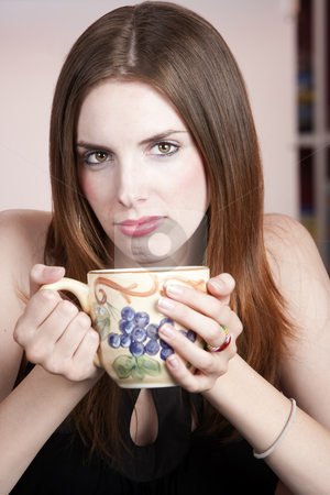 Pretty woman with mug stock photo, Woman with big mug in coffee house by Scott Griessel