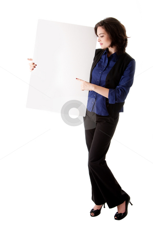Young business woman with white board stock photo, Happy smiling beautiful young caucasian brunette business student woman standing next to and holding a white blank board and pointing at it, isolated by Paul Hakimata