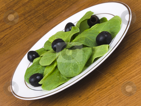 Spinach Salad stock photo, Spinach salad with black olives on a plate by John Teeter