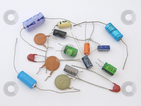 Assorted capacitors stock photo, Assorted capacitors as used in a computer. by Ian Langley