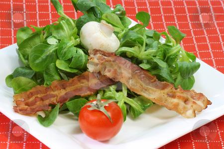 Field salad stock photo, Field salad on a plate on red background by Birgit Reitz-Hofmann