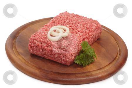 Meatloaf stock photo, Raw mincemeat on a kitchen board on bright background by Birgit Reitz-Hofmann