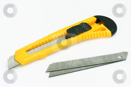 Yellow Cutter stock photo, Box cutter and blades on bright background by Birgit Reitz-Hofmann