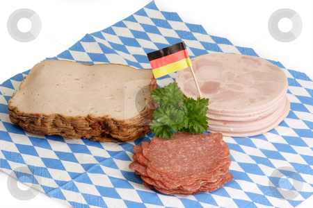 Sliced sausage stock photo, Fresh sliced sausage on bavarian napkin background by Birgit Reitz-Hofmann