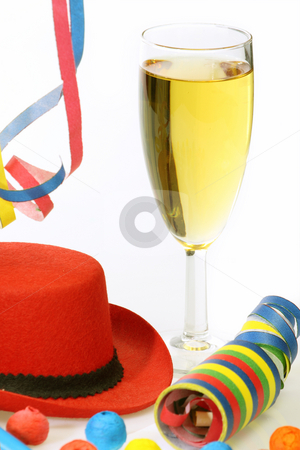 Throwing a party stock photo, Glass of champagne and party goods on bright background by Birgit Reitz-Hofmann